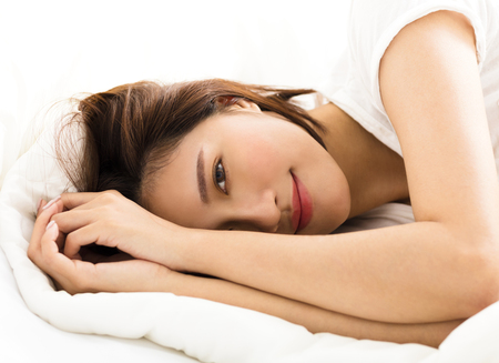 young beautiful woman sleeping in the bed