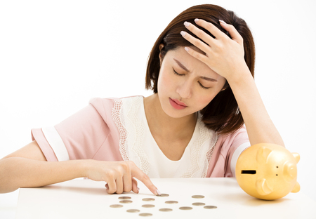 stress young woman with piggy bank