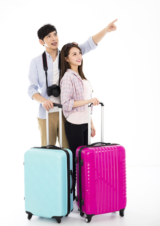 happy young couple with suitcase going on vacation 스톡 콘텐츠