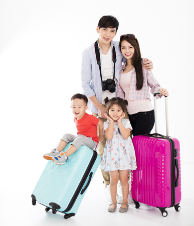 happy family with suitcase going on vacation  Banco de Imagens