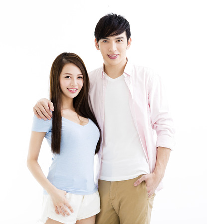 face to face: Portrait of  smiling asian young couple