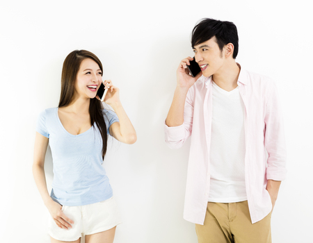 happy young couple talking on the phone
