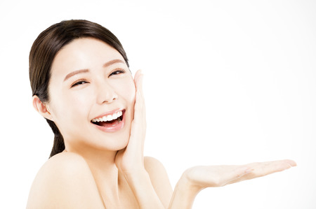 happy Beauty woman showing  beauty product on her hand  Stock Photo