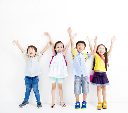 Group of happy smiling kids raise hands Stock fotó