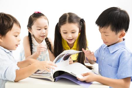 group of school kids studing together Standard-Bild