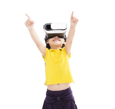 Amazed little girl looking in  VR goggles