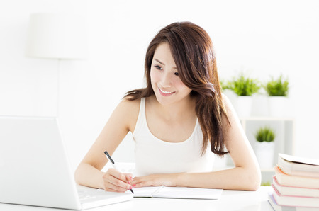 mobile: happy female student studying with laptop Stock Photo