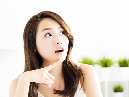 young  asian woman relaxing and thinking