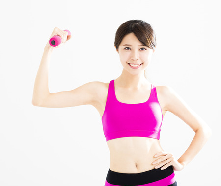 healthy body: happy fitness woman working out with dumbbells
