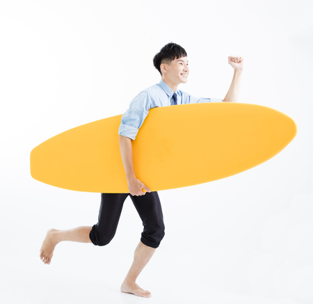 business man with surfboard and summer vacation concept