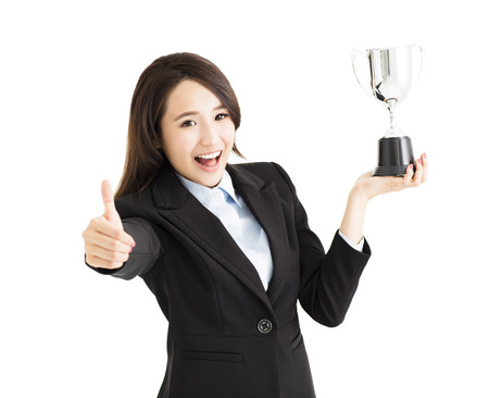 happy Businesswoman showing trophy and thumb up photo