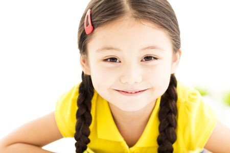 comfortable: closeup Portrait of  smiling little girl Stock Photo