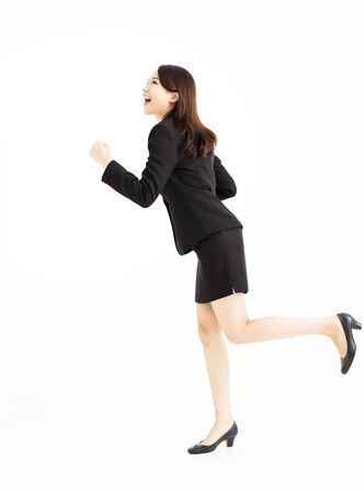 happy business woman running and looking up