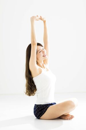 healthy body: Young smiling woman doing stretching and yoga