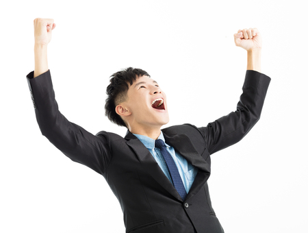 Excited businessman celebration success with hand up