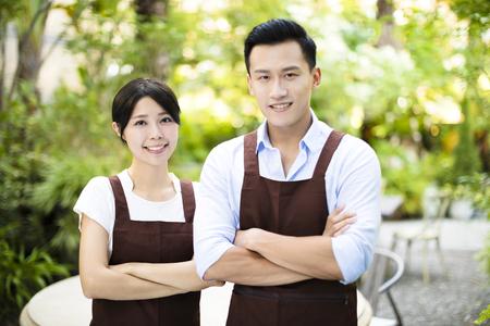 garden restaurant owner standing with partner Banque d'images