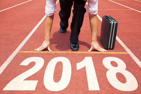 実行する準備ができてのビジネスマンおよび 2018 年コンセプト