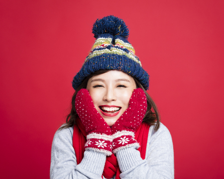Happy Young Beautiful Woman in winter clothes  Stock Photo