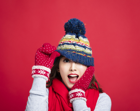 Happy Young Beautiful Woman in winter clothes Standard-Bild