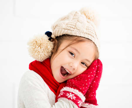 happy little girl in winter clothes