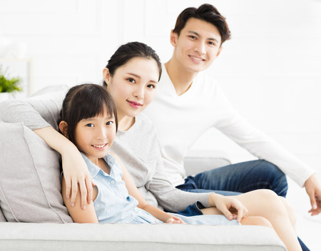 Happy asian family on sofa in living room 스톡 콘텐츠