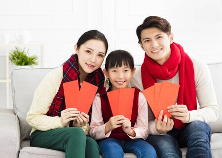 happy chinese new year. asian family with Congratulation gesture