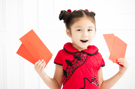 happy chinese new year. little girls holding red envelope