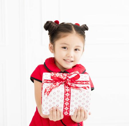 little girl showing gift for chinese new year Stock Photo