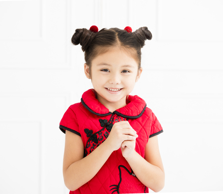 chinese little girl with congratulation gesture 스톡 콘텐츠