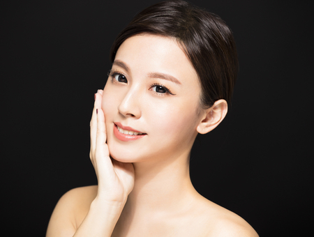 closeup Beauty woman face isolated on black background Stock Photo