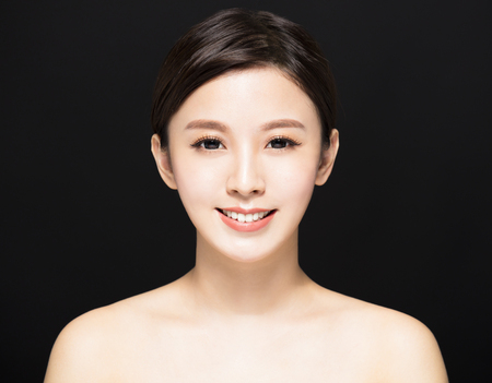 closeup Beauty woman face isolated on black background 版權商用圖片