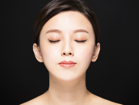 closeup Beauty woman face isolated on black background Stock fotó - 88986523