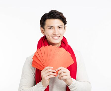 smiling asian man showing the red envelope