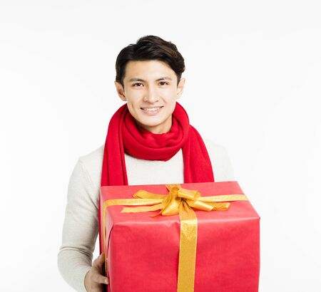 happy young man showing christmas gifts stock photo 89273910