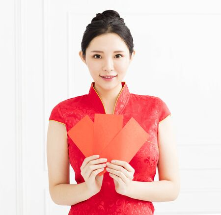young asian woman showing the red envelope