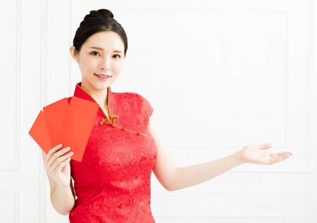 smiling woman showing the red envelope and introducing something Stock Photo