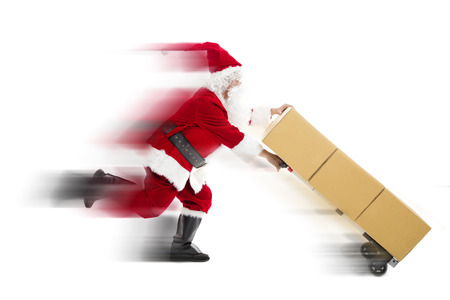 Santa Claus running and delivering Christmas presents Stockfoto