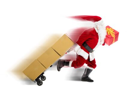 Santa Claus running and delivering Christmas presents  Stock Photo