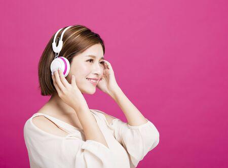 woman listening music with headphones Stock Photo