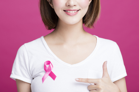 Woman hand showing pink breast cancer awareness ribbon 스톡 콘텐츠