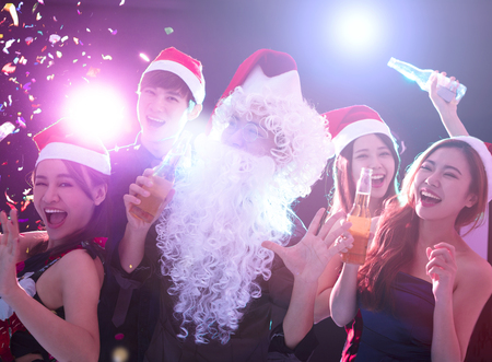 young group Enjoying Christmas party and having fun Stock Photo