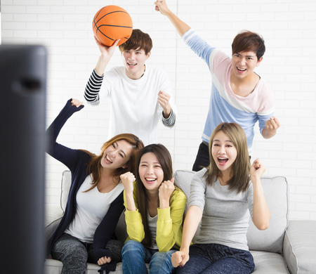 young group Watching Sports On Television And Cheering Stock Photo - 91442610