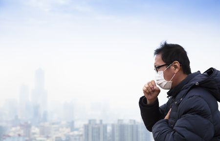 Lung cancer patients with smog city background Stock Photo