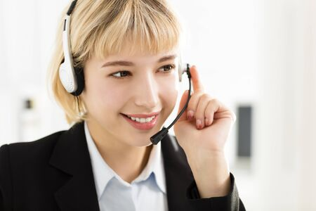 young smiling business woman with headset  Stock Photo