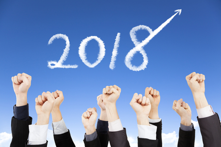 business people showing fist with 2018 year concept