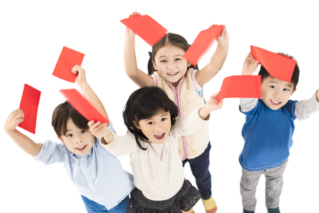 happy children showing red envelope for chinese new year