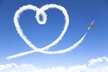 love cloud concept drowing by airplane