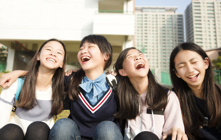 Group Of Teenage Students girls having fun outdoor Banque d'images