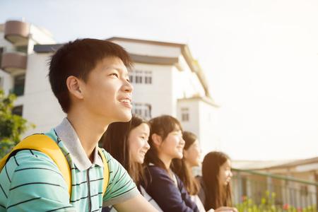 Group Of Teenage Studentssitting in school