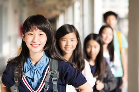 Group Of Teenage Studentsstanding before classroom Stockfoto